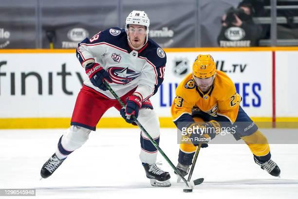 Pierre-Luc Dubois of the Columbus Blue Jackets skates against Rocco Grimaldi of the Nashville Predators at Bridgestone Arena on January 14, 2021 in...