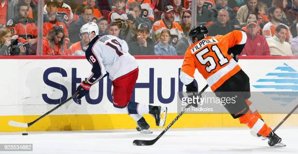 PierreLuc Dubois of the Columbus Blue Jackets skates the puck along the boards against Valtteri Filppula of the Philadelphia Flyers on February 22...