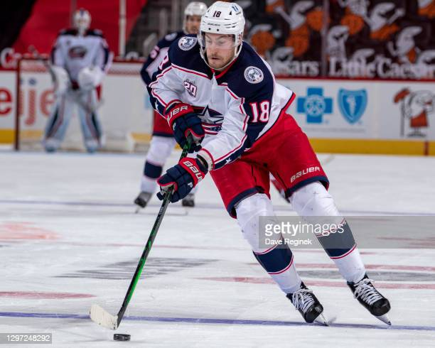 Pierre-Luc Dubois of the Columbus Blue Jackets skates up ice with the puck against the Detroit Red Wings during an NHL game at Little Caesars Arena...