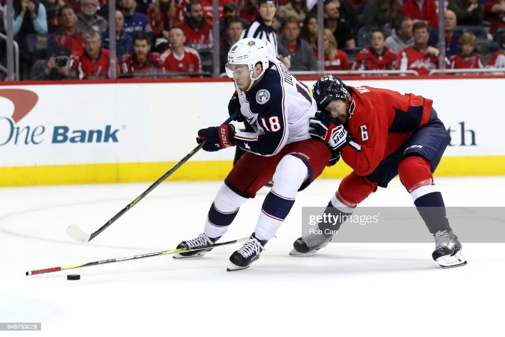 Pierre-Luc Dubois #18 of the Columbus Blue Jackets skates with the puck in front of Michal Kempny #6 of the Washington Capitals during Game Two of the Eastern Conference First Round during the 2018 NHL Stanley Cup Playoffs at Capital One Arena on April 15, 2018 in Washington, DC.