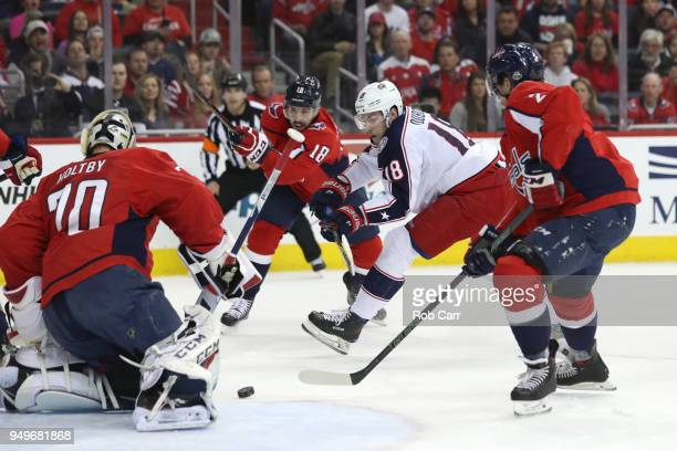 PierreLuc Dubois of the Columbus Blue Jackets takes a shot on goalie Braden Holtby of the Washington Capitals in the first period during Game Five of...