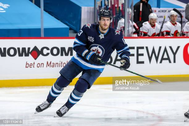 Pierre-Luc Dubois of the Winnipeg Jets follows the play down the ice during second period action against the Ottawa Senators at the Bell MTS Place on...
