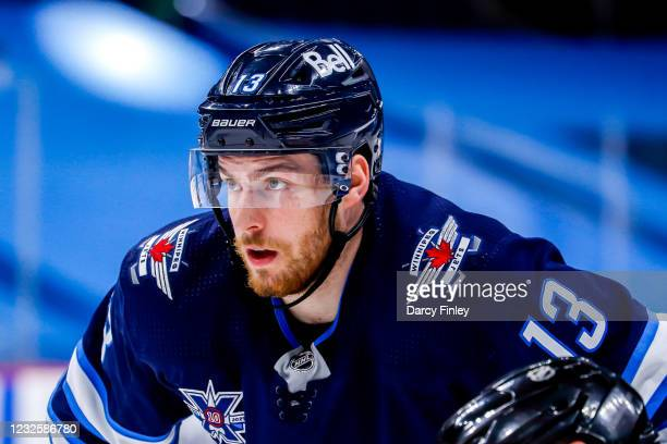 Pierre-Luc Dubois of the Winnipeg Jets looks on as he gets set for a second period face-off against the Edmonton Oilers at the Bell MTS Place on...