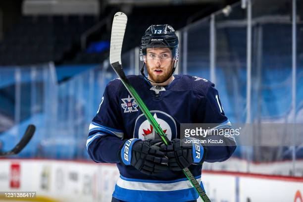 Pierre-Luc Dubois of the Winnipeg Jets looks on during a first period stoppage in play against the Montreal Canadiens at the Bell MTS Place on...