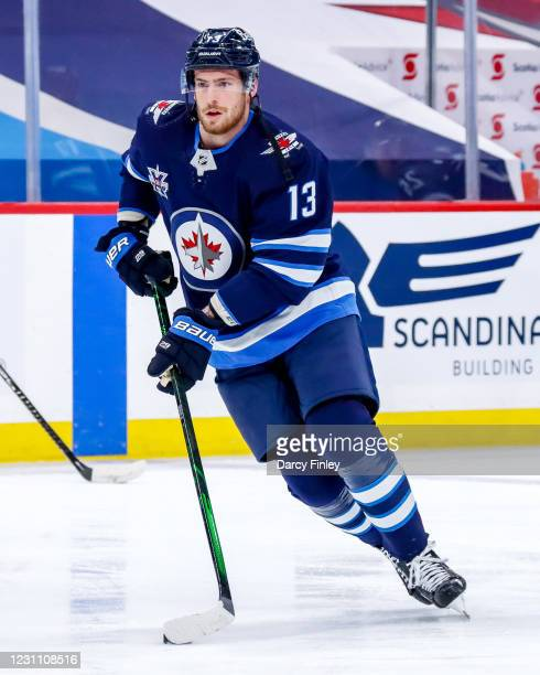 Pierre-Luc Dubois of the Winnipeg Jets takes part in the pre-game warm up prior to NHL action against the Ottawa Senators at the Bell MTS Place on...