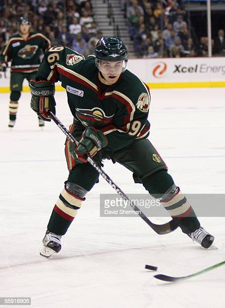 Pierre-Marc Bouchard of the Minnesota Wild looks to make a play against the Calgary Flames during their season opening game on October 5, 2005 at the...