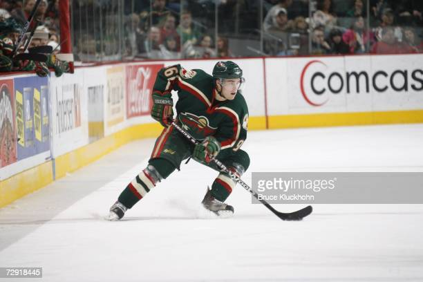 PierreMarc Bouchard of the Minnesota Wild skates against the Anaheim Ducks during the game at Xcel Energy Center on December 31 2006 in Saint Paul...