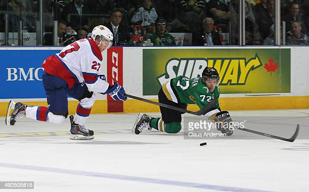 PierreMaxime Poudrier of the Val'Dor Foreurs slides to knock the puck away from a streaking Curtis Lazar of the Edmonton Oil Kings during Game Five...