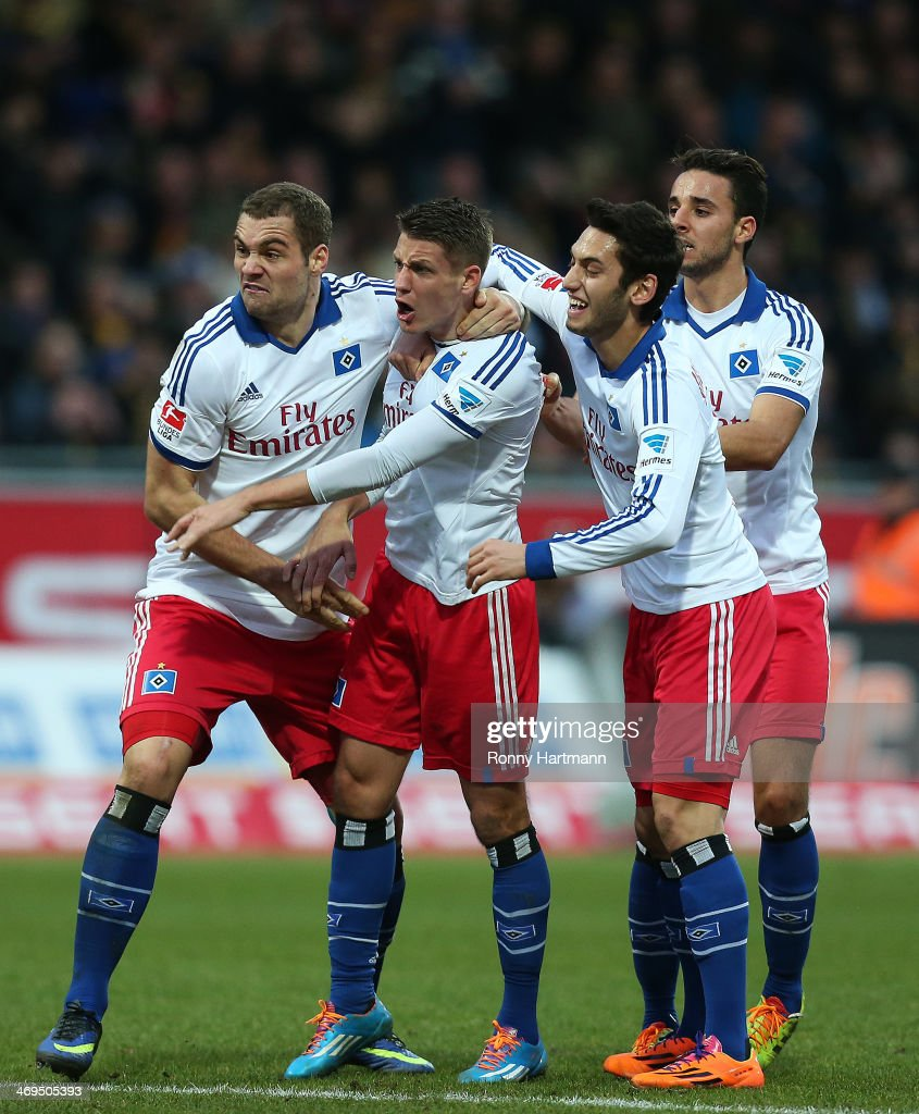 Pierre-Michel Lasogga, Ivo Ilicevic, Hakan Calhanoglu and Ouasim Bouy of Hamburg celebrate their teams second goal during the Bundesliga match between Eintracht Braunschweig and Hamburger SV at Eintracht Stadion on February 15, 2014 in Braunschweig, Germany.
