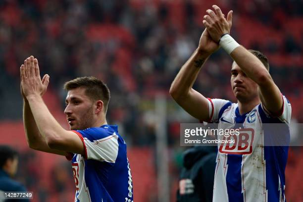 PierreMichel Lasogga of Berlin and teammate Tunay Torun celebrate after the Bundesliga match between Bayer 04 Leverkusen and Hertha BSC Berlin at...