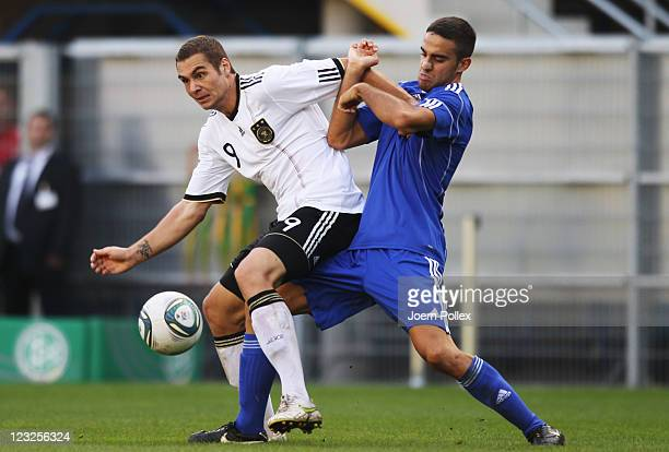PierreMichel Lasogga of Germany and Matteo Colonna of San Marino battle for the ball during the 2013 UEFA European Under21 Qualifier Group 1 match...