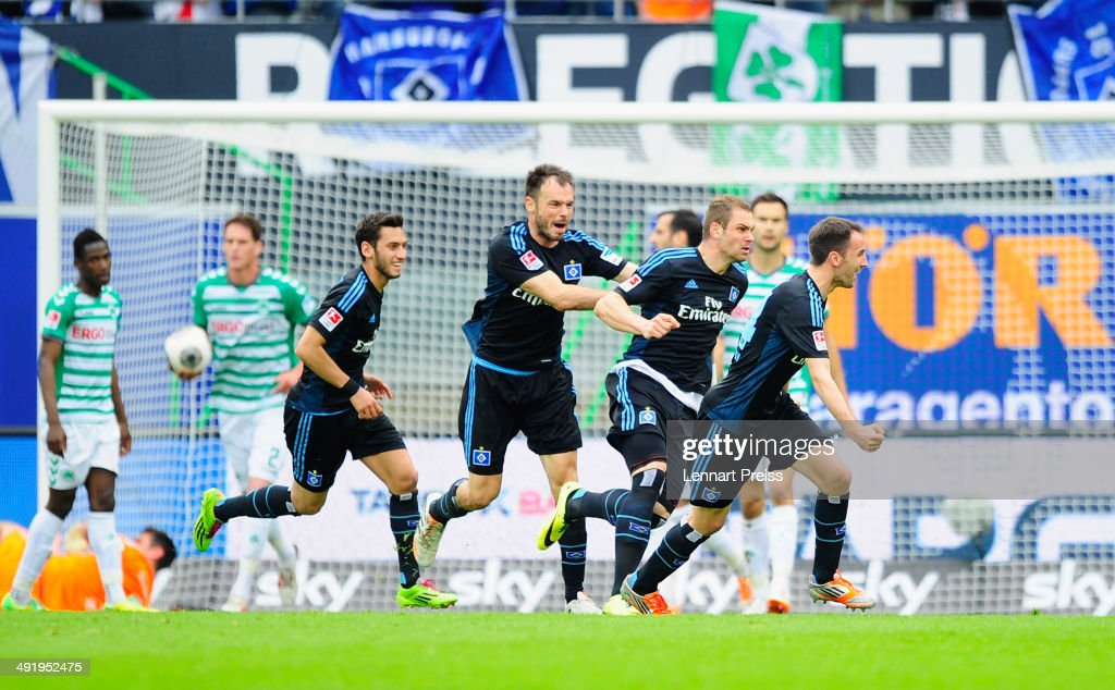 Pierre-Michel Lasogga (2R) of Hamburg and his teammates celebrate the opening goal during the Bundesliga Playoff Second Leg match between SpVgg Greuther Fuerth and Hamburger SV at Trolli-Arena on May 18, 2014 in Fuerth, Germany.