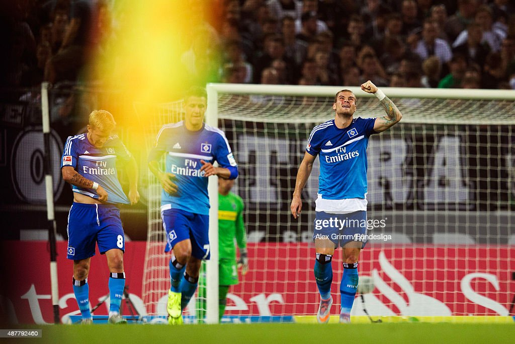 Pierre-Michel Lasogga (R) of Hamburg celebrates a goal with team mates during the Bundesliga match between Borussia Moenchengladbach and Hamburger SV at Borussia-Park on September 11, 2015 in Moenchengladbach, Germany.