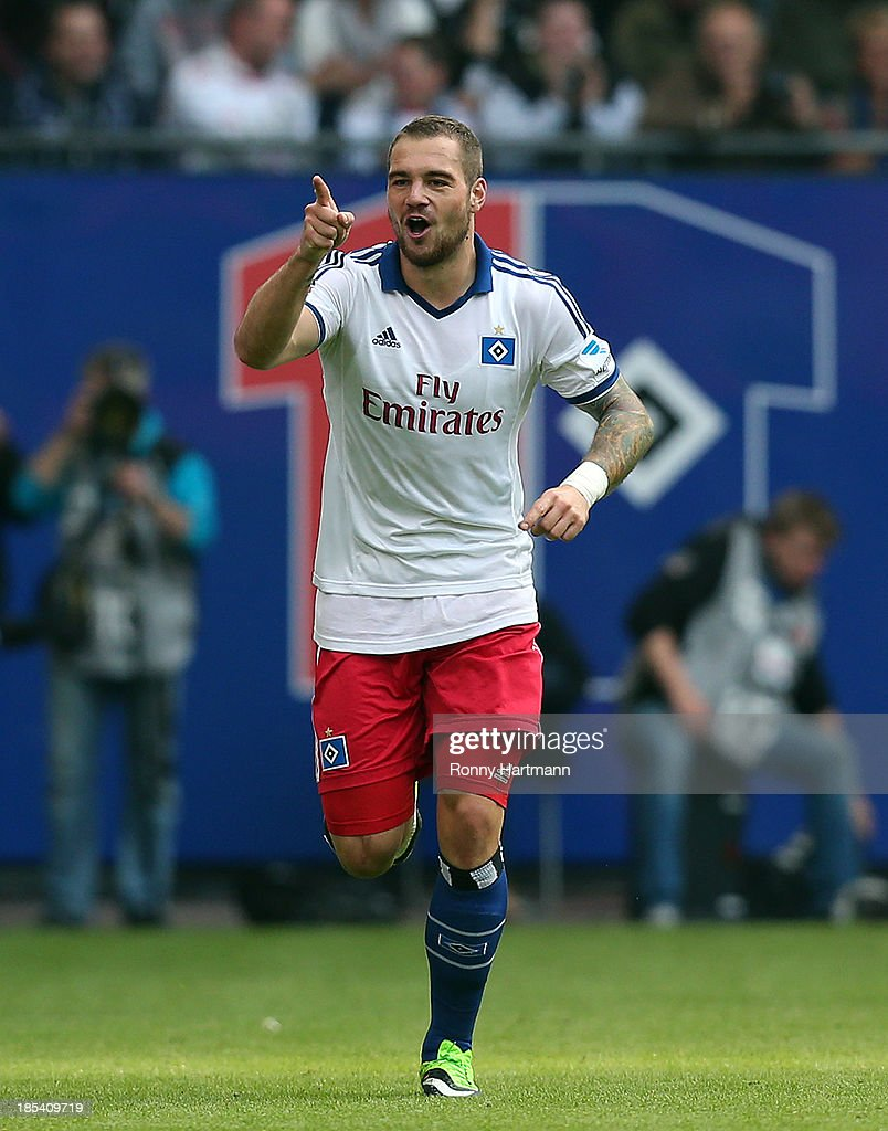Pierre-Michel Lasogga of Hamburg celebrates his teams first goal during the Bundesliga match between Hamburger SV and VfB Stuttgart at Imtech Arena on October 20, 2013 in Hamburg, Germany.