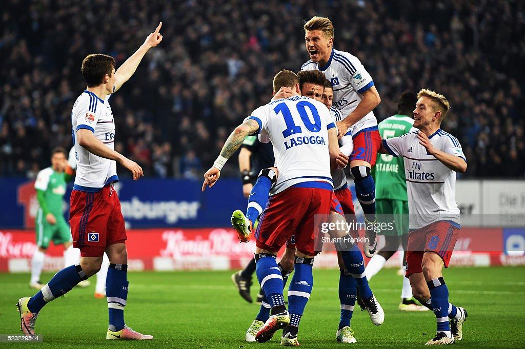 Pierre-Michel Lasogga #10 of Hamburg celebrates his team's first goal with team mates during the Bundesliga match between Hamburger SV and Werder Bremen at Volksparkstadion on April 22, 2016 in Hamburg, Germany.