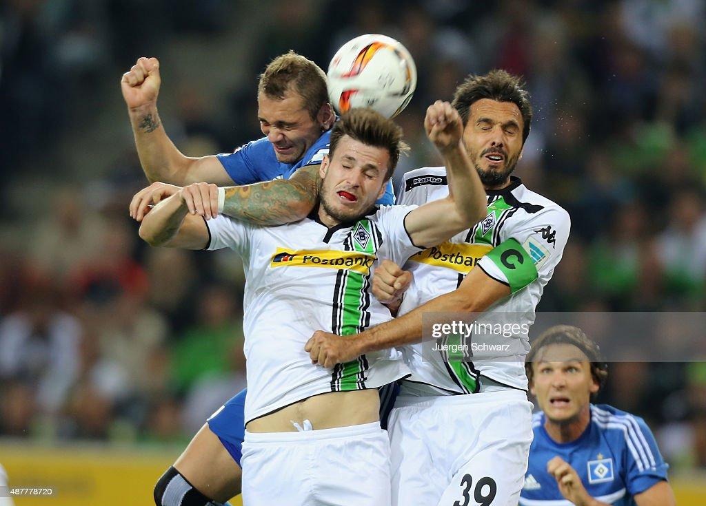 Pierre-Michel Lasogga of Hamburg, Havard Nordveit and Martin Stranzl of Moenchengladbach jump for the ball during the Bundesliga match between Borussia Moenchengladbach and Hamburger SV at Borussia-Park on September 11, 2015 in Moenchengladbach, Germany.