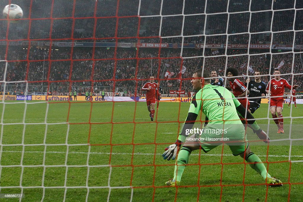 Pierre-Michel Lasogga (2nd R) of Hamburg scores his first team goal during the Bundesliga match between FC Bayern Muenchen and Hamburger SV at Allianz Arena on September 28, 2013 in Munich, Germany.