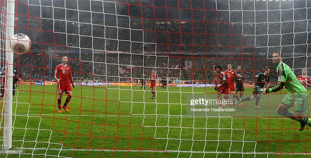 Pierre-Michel Lasogga (3rd R) of Hamburg scores his first team goal during the Bundesliga match between FC Bayern Muenchen and Hamburger SV at Allianz Arena on September 28, 2013 in Munich, Germany.