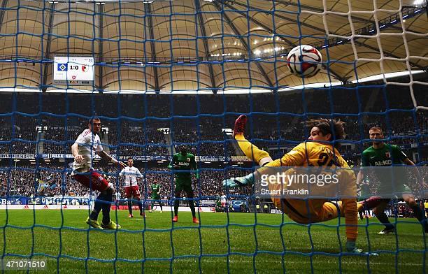 PierreMichel Lasogga of Hamburg scores his goal during the Bundeslga match between Hamburger SV and FC Augsburg at Imtech Arena on April 25 2015 in...