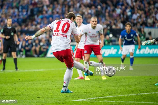 PierreMichel Lasogga of Hamburg scores his teams first goal during the Bundesliga match between FC Schalke 04 and Hamburger SV at VeltinsArena on May...