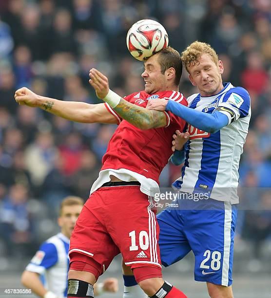 PierreMichel Lasogga of Hamburger SV and Fabian Lustenberger of Hertha BSC beim Kopfballduell during the game between Hertha BSC and Hamburger SV on...