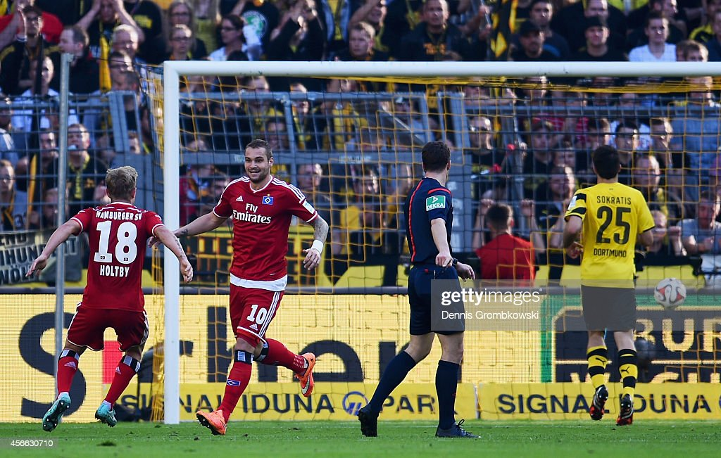 Pierre-Michel Lasogga of Hamburger SV celebrates as he scores the first goal during the Bundesliga match between Borussia Dortmund and Hamburger SV at Signal Iduna Park on October 4, 2014 in Dortmund, Germany.