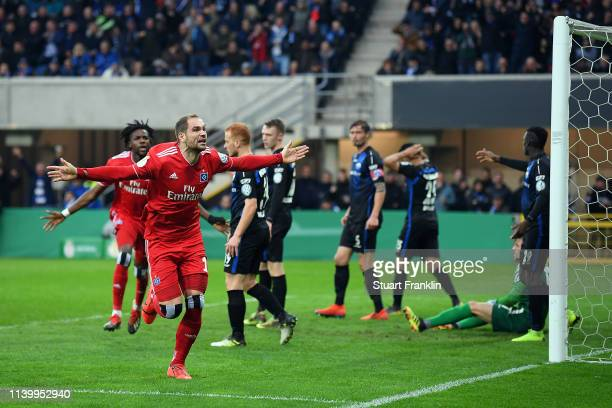 Pierre-Michel Lasogga of Hamburger SV celebrates scoring during the DFB Cup match between SC Paderborn 07 and Hamburger SV at Benteler Arena on April...