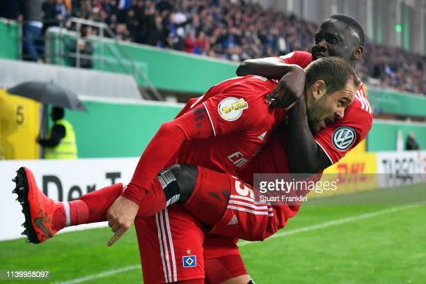 PierreMichel Lasogga of Hamburger SV celebrates scoring his second goal with team mate Orel Mangala during the DFB Cup match between SC Paderborn 07...