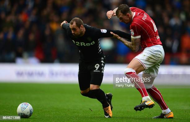 PierreMichel Lasogga of Leeds United is tackled by Aden Flint of Bristol City during the Sky Bet Championship match between Bristol City and Leeds...