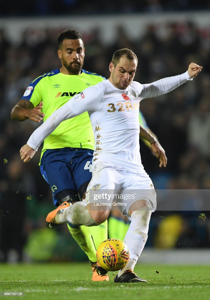 Pierre-Michel Lasogga of Leeds United takes a shot at goal under pressure from Tom Huddlestone of Derby Countyduring the Sky Bet Championship match between Leeds United and Derby County at Elland Road on October 31, 2017 in Leeds, England.
