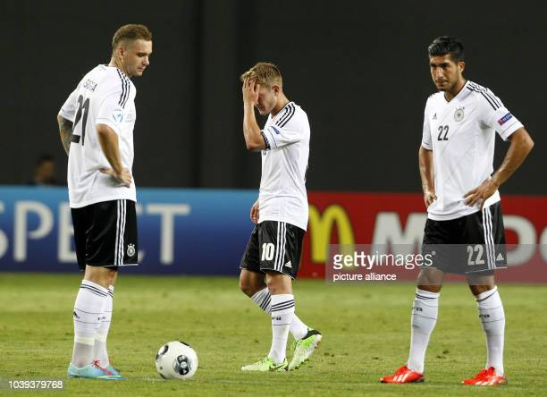 PierreMichelle Lasogga Lewis Holtby and Emre Can of Germany react during the UEFA European Under21 Championship Group B soccer match between Spain...
