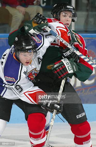 Pierre-Olivier Beaulieu of the Halifax Mooseheads tries to clear Olivier Labelle of Gatineau Olympiques from the slot during the Quebec Major Junior...