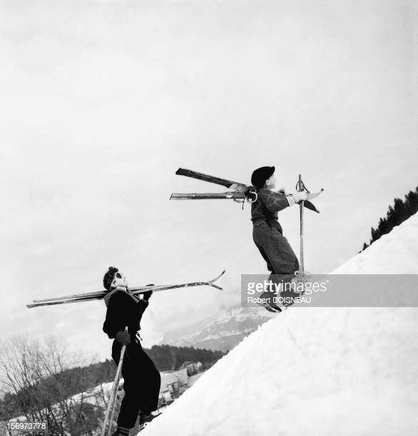 Pierrette and Michel Soulages going up on the ski slope, 1936 in Megeve, France.