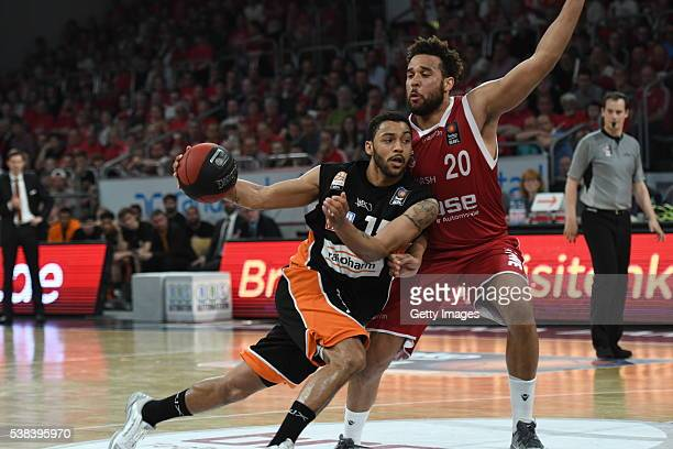 Pierria Henry draws to the basket against Elias Harris during the BEKO BBL Final game 1 between Brose Baskets Bamberg and ratipopharm Ulm at Brose...