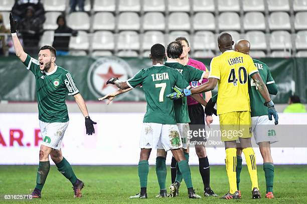 Pierrick Cros and team of Red Star looks dejected after the decision of the referee Willy Delajod during the Ligue 2 match between Red Star and...