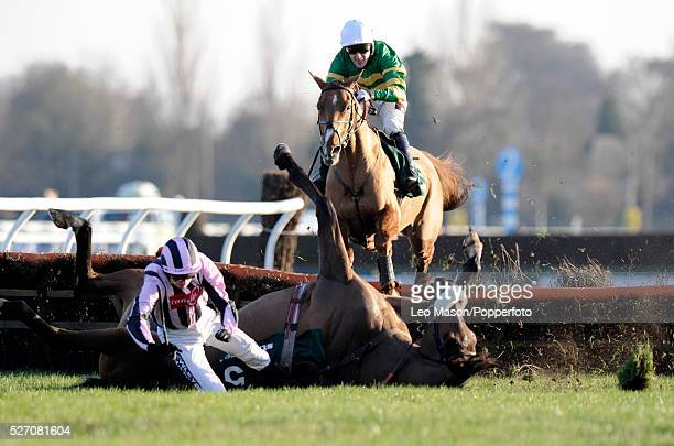Pierrot Lunaire and Ruby Walsh fall at the last fence, with Straw Bear and Tony McCoy behind, during the Stan James Christmas Hurdle Race at the 2008...