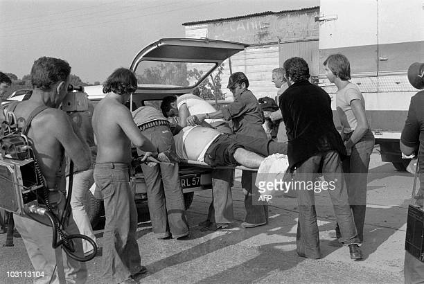 Pierrot Susini a wounded Corsican autonomist activist is evacuated during a truce in the hostagetaking in a wineyard in Aleria on August 22 1975 A...