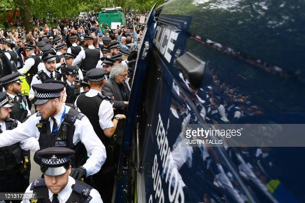 Piers Corbyn , brother of former Labour Party leader Jeremy Corbyn, is led away by police officers into a police van at an anti-coronavirus lockdown...