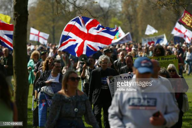 """Piers Corbyn walks with protestors during a """"Unite For Freedom"""" anti-lockdown demonstration held to protest against the use of vaccine passports in..."""