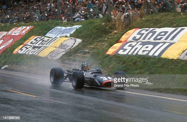 Piers Courage of Great Britain drives rhe Reg Parnell Racing BRM P126 BRM in the rain during the wet French Grand Prix on 7th July 1968 at the...