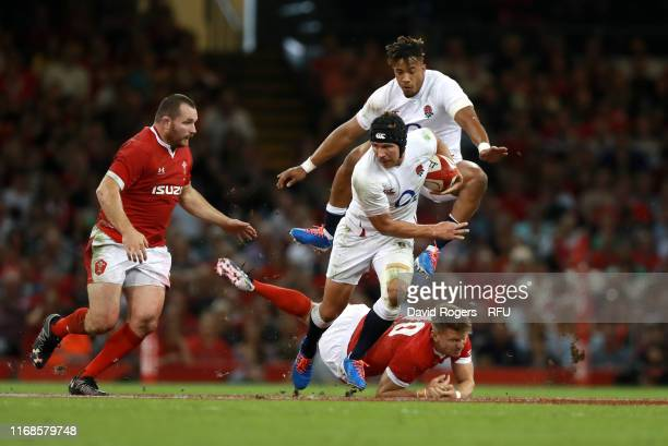 Piers Francis of England and Anthony Watson of England break through the tackle of Dan Biggar of Wales during the Under Armour Summer Series match...