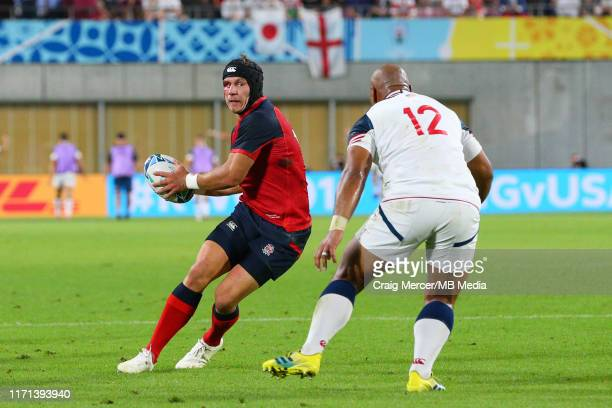 Piers Francis of England sells a dummy to Paul Lasike of USA during the Rugby World Cup 2019 Group C game between England and USA at Kobe Misaki...