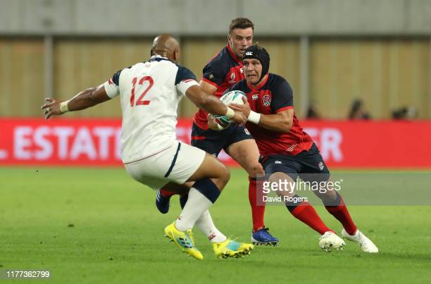 Piers Francis of England takes on Paul Lasike during the Rugby World Cup 2019 Group C game between England and USA at Kobe Misaki Stadium on...