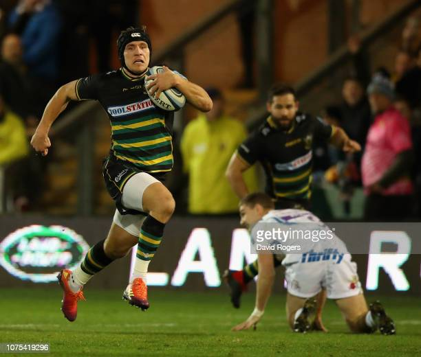 Piers Francis of Northampton Saints breaks clear to score their first try during the Gallagher Premiership Rugby match between Northampton Saints and...