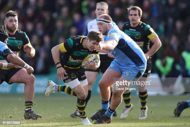 Piers Francis of Northampton Saints is tackled by Ollie Hoskins of London Irish during the Aviva Premiership match between Northampton Saints and...
