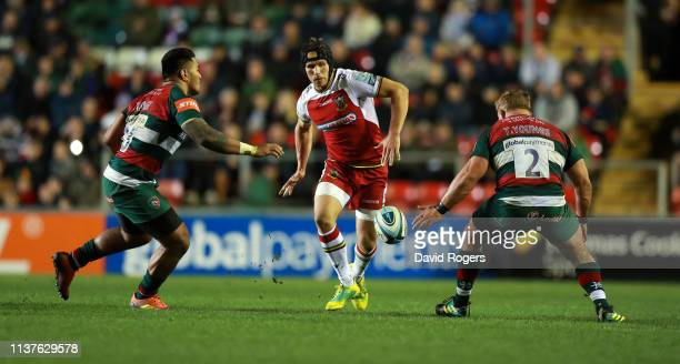 Piers Francis of Northampton Saints kicks the ball past Manu Tuilagi and Tom Youngs during the Gallagher Premiership Rugby match between Leicester...