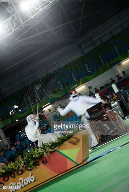 Piers Gilliver of Great Britain battles Gang Sun of China in the final of Wheelchair Fencing Mens Ind Epee Category A on day 6 of the Rio 2016...