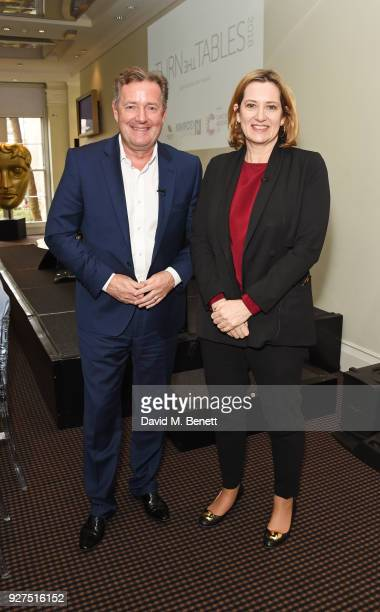 Piers Morgan and Amber Rudd Secretary of State for the Home Department attend Turn The Tables 2018 hosted by Tania Bryer and James Landale in aid of...