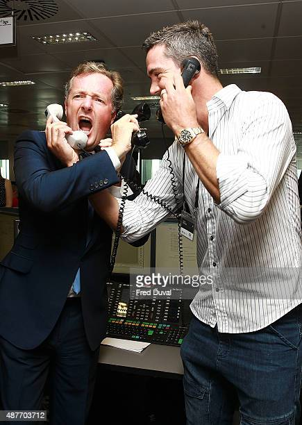 Piers Morgan and Kevin Pietersen attend the annual BGC Global Chariry Day at BGC Partners on September 11 2015 in London England