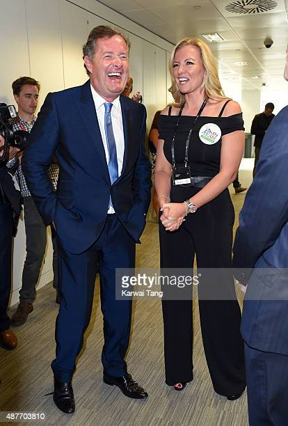 Piers Morgan and Michelle Mone attend the annual BGC Global Charity Day at BGC Partners on September 11 2015 in London England